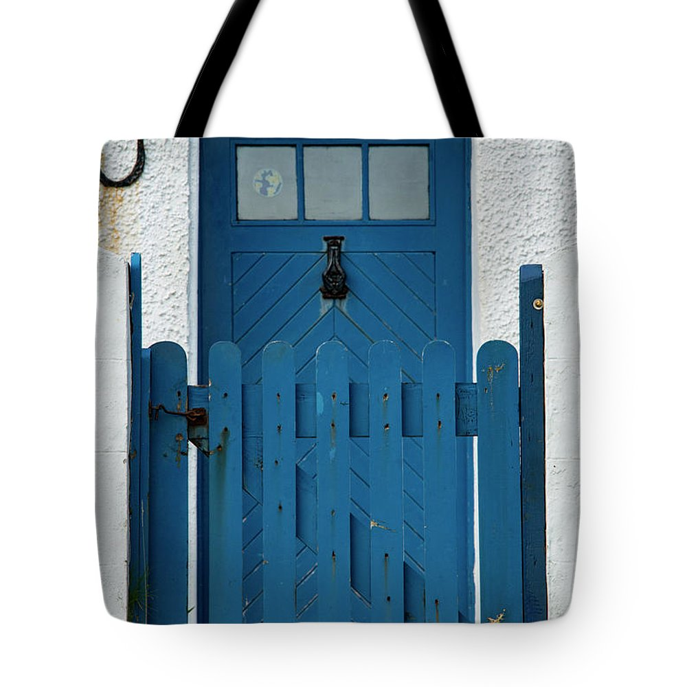 Isle Of Iona Tote Bag featuring the photograph Blue Gate And Door On White House by Bob Phillips