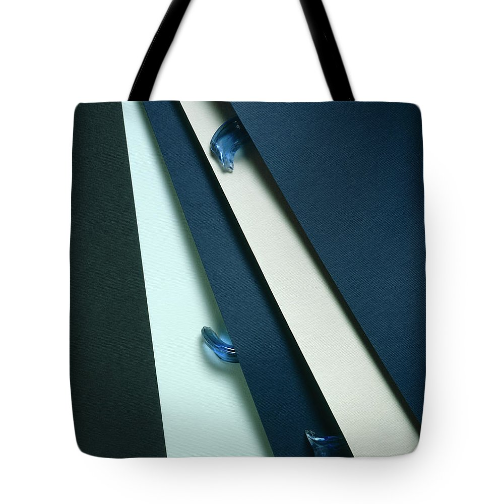 Arty Tote Bag featuring the photograph Blue Glass And Paper by Stefania Levi
