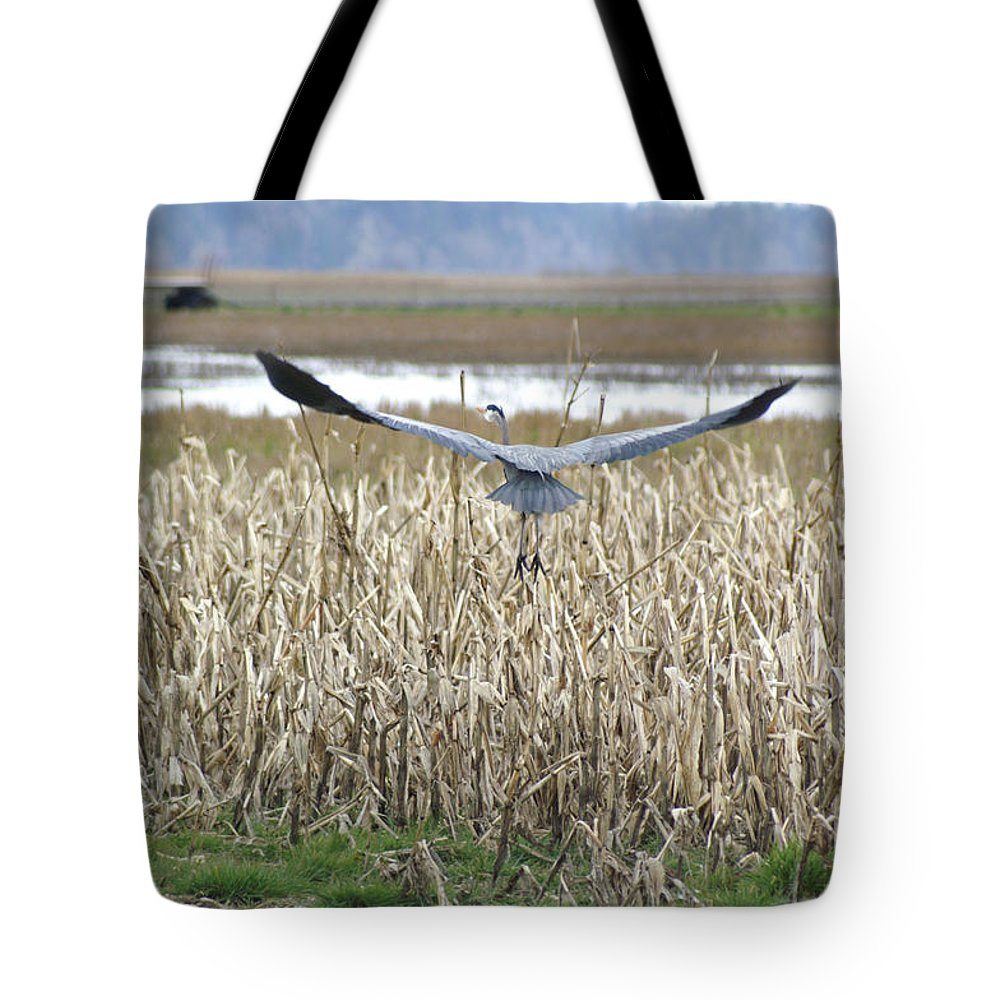 Heron Tote Bag featuring the photograph Blue Heron Flight by Louise Magno