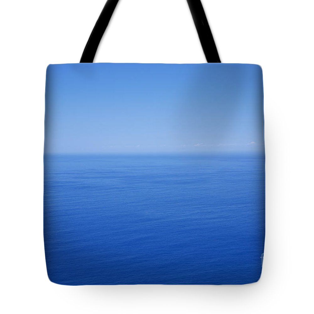 Tranquility Tote Bag featuring the photograph Blue Horizon by Gaspar Avila
