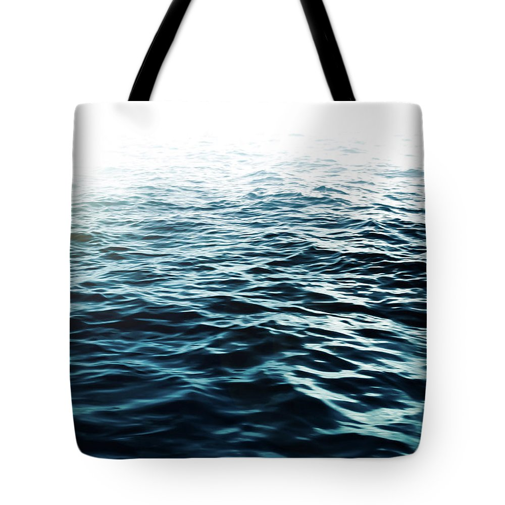 Sea Tote Bag featuring the photograph Blue Sea by Nicklas Gustafsson