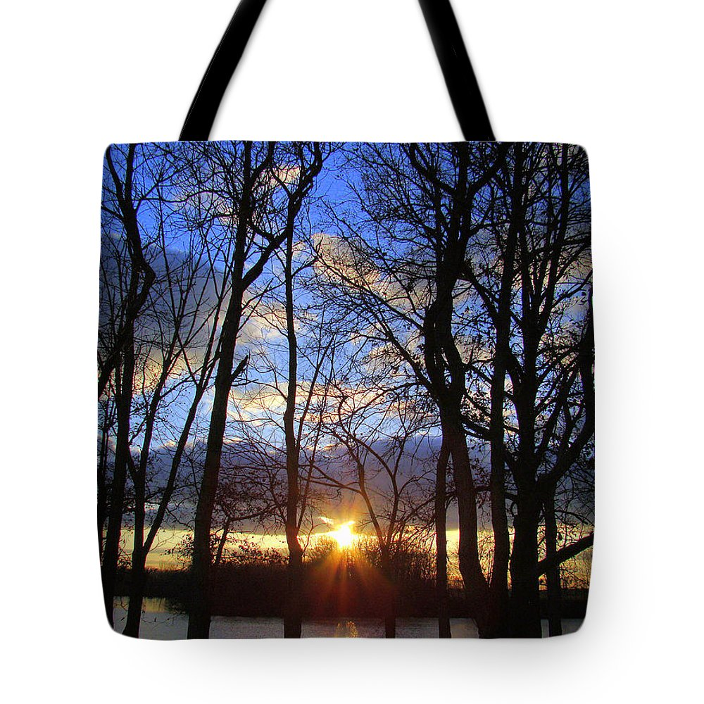 Sunset Tote Bag featuring the photograph Blue Skies And Golden Sun by J R Seymour