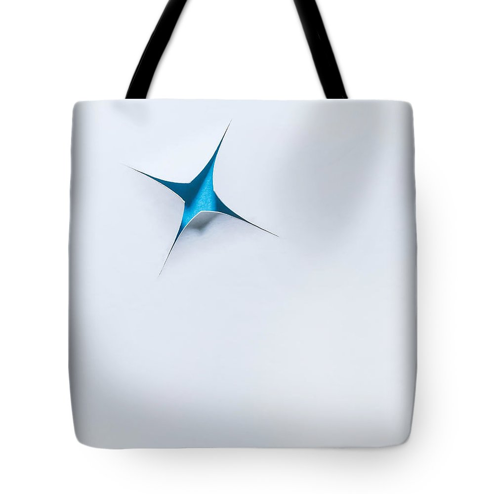 Scott Norris Photography Tote Bag featuring the photograph Blue Star On White by Scott Norris
