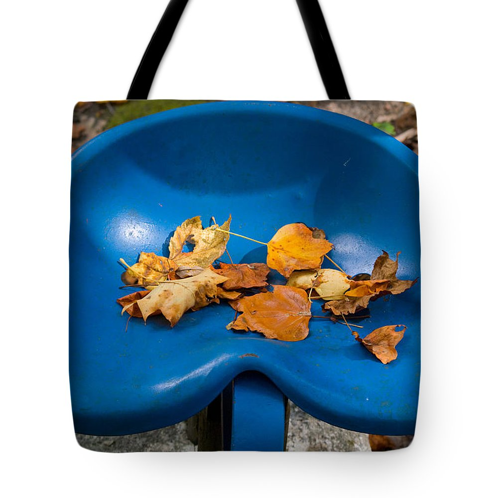 Cumberland Tote Bag featuring the photograph Blue Tractor Seat by Douglas Barnett