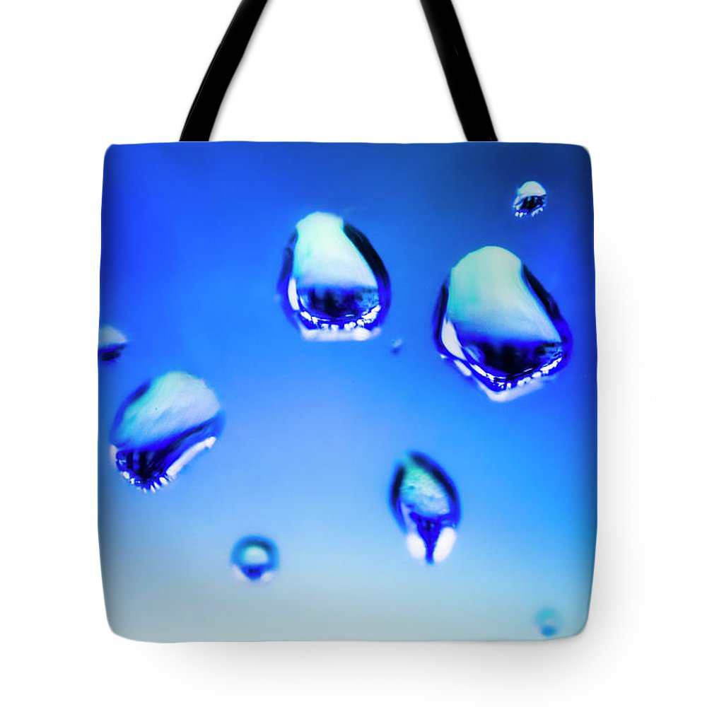 Water Tote Bag featuring the photograph Blue Water Droplets On Glass by Jorgo Photography - Wall Art Gallery