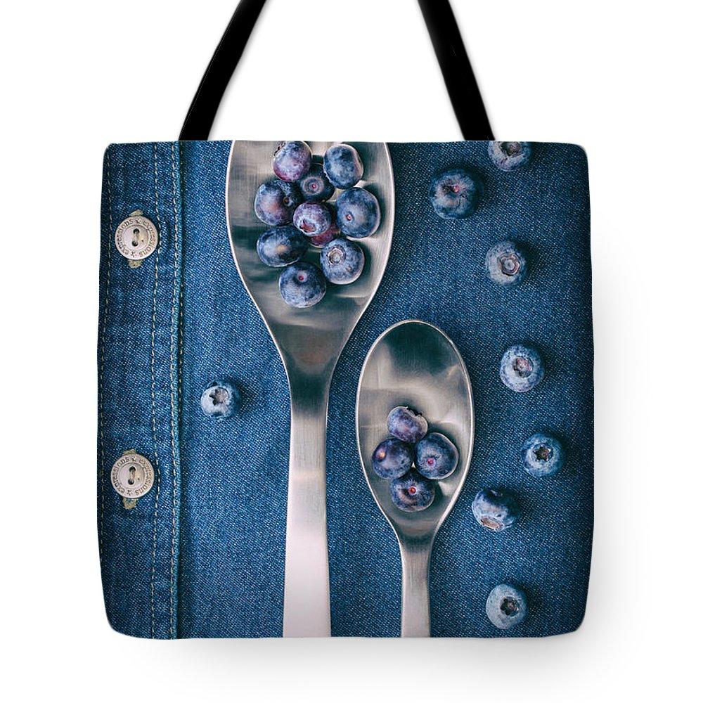 Abundance Tote Bag featuring the photograph Blueberries On Denim I by Tom Mc Nemar