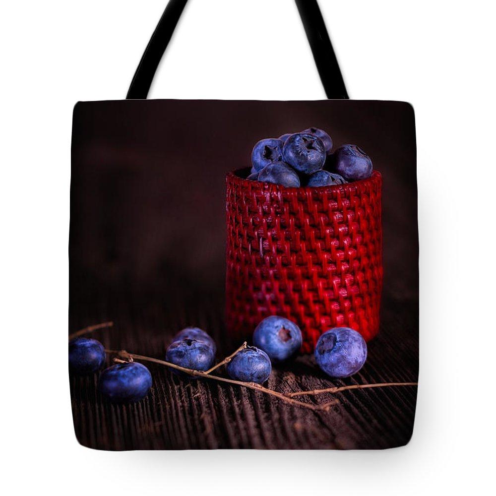 7b7c67c9539 Abundance Tote Bag featuring the photograph Blueberry Delight by Tom Mc  Nemar