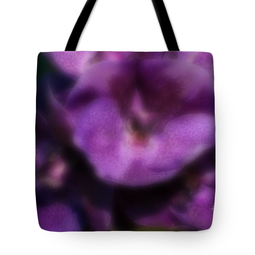 Violet Tote Bag featuring the photograph Blurred Seasonal Orchid Flowers With Dark Green Background by Rudra Narayan Mitra