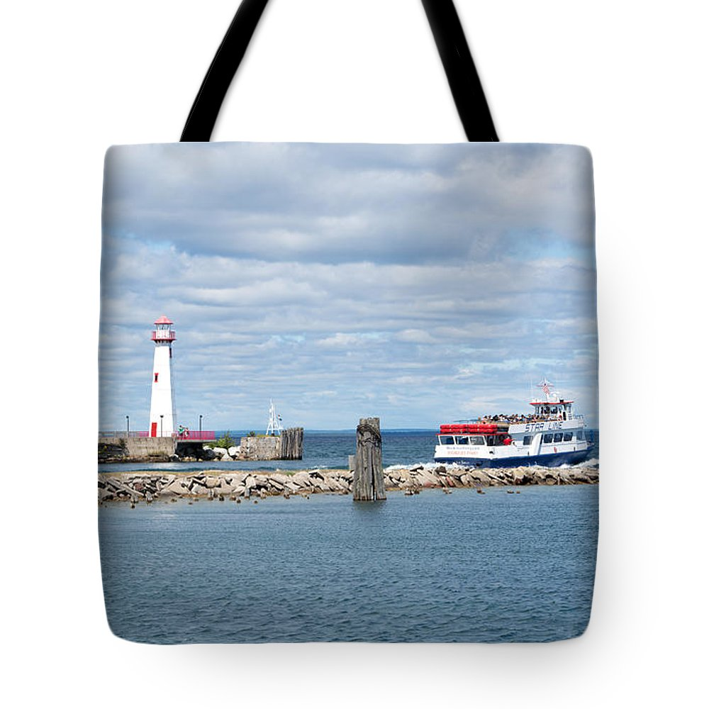 St. Ignace Lighthouse Tote Bag featuring the photograph Boat Leaving by Linda Kerkau