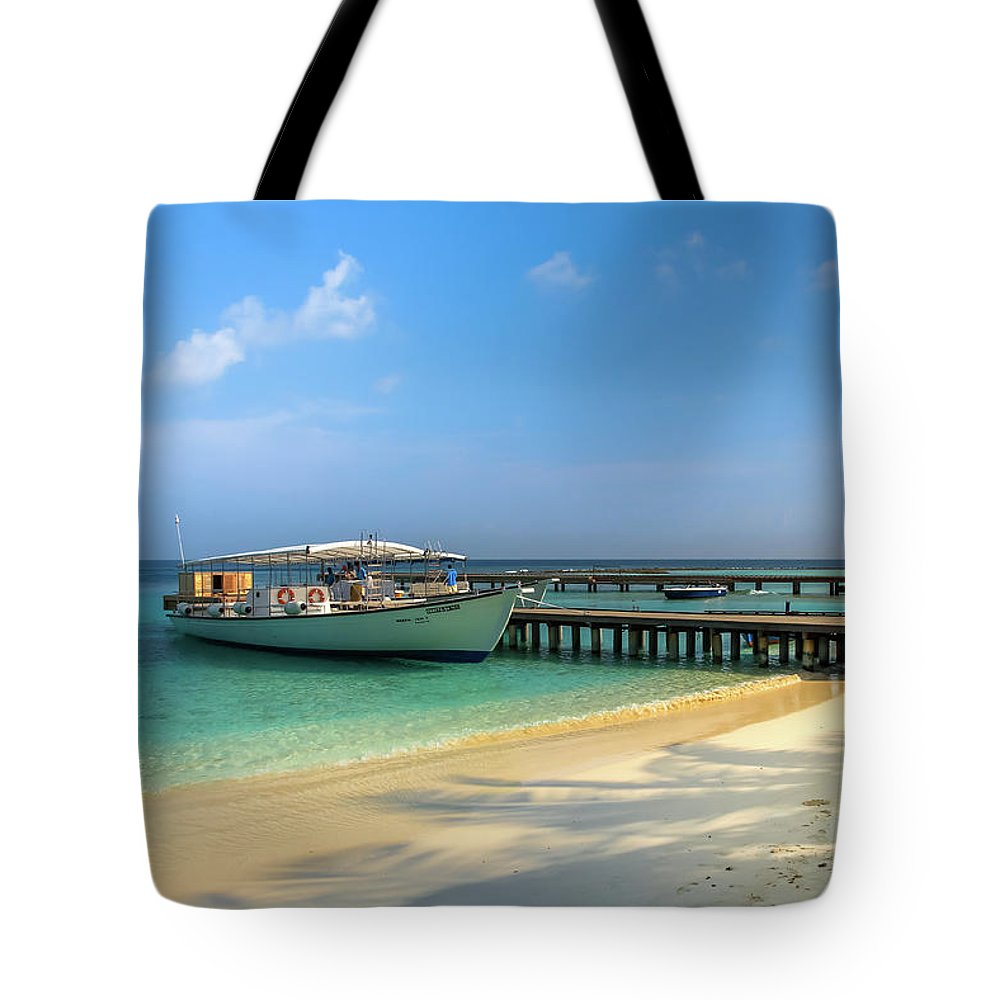Boat On Tropical Island Tote Bag featuring the photograph Boat On A Tropical Island by Yana Reint
