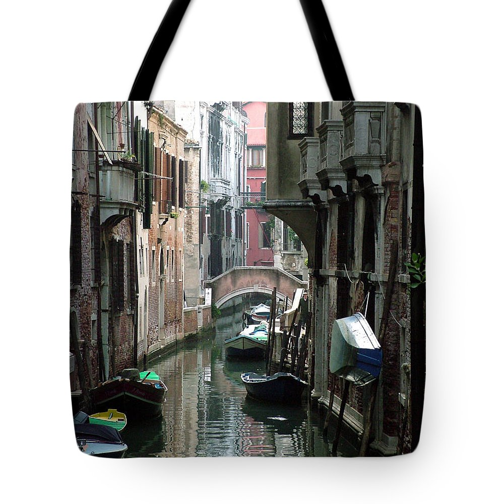 Venice Tote Bag featuring the photograph Boat On The Wall by Donna Corless
