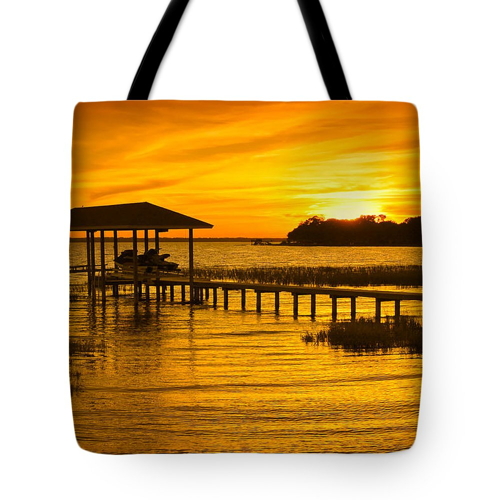 Sunset Tote Bag featuring the photograph Boathouse Sunset by Rich Leighton