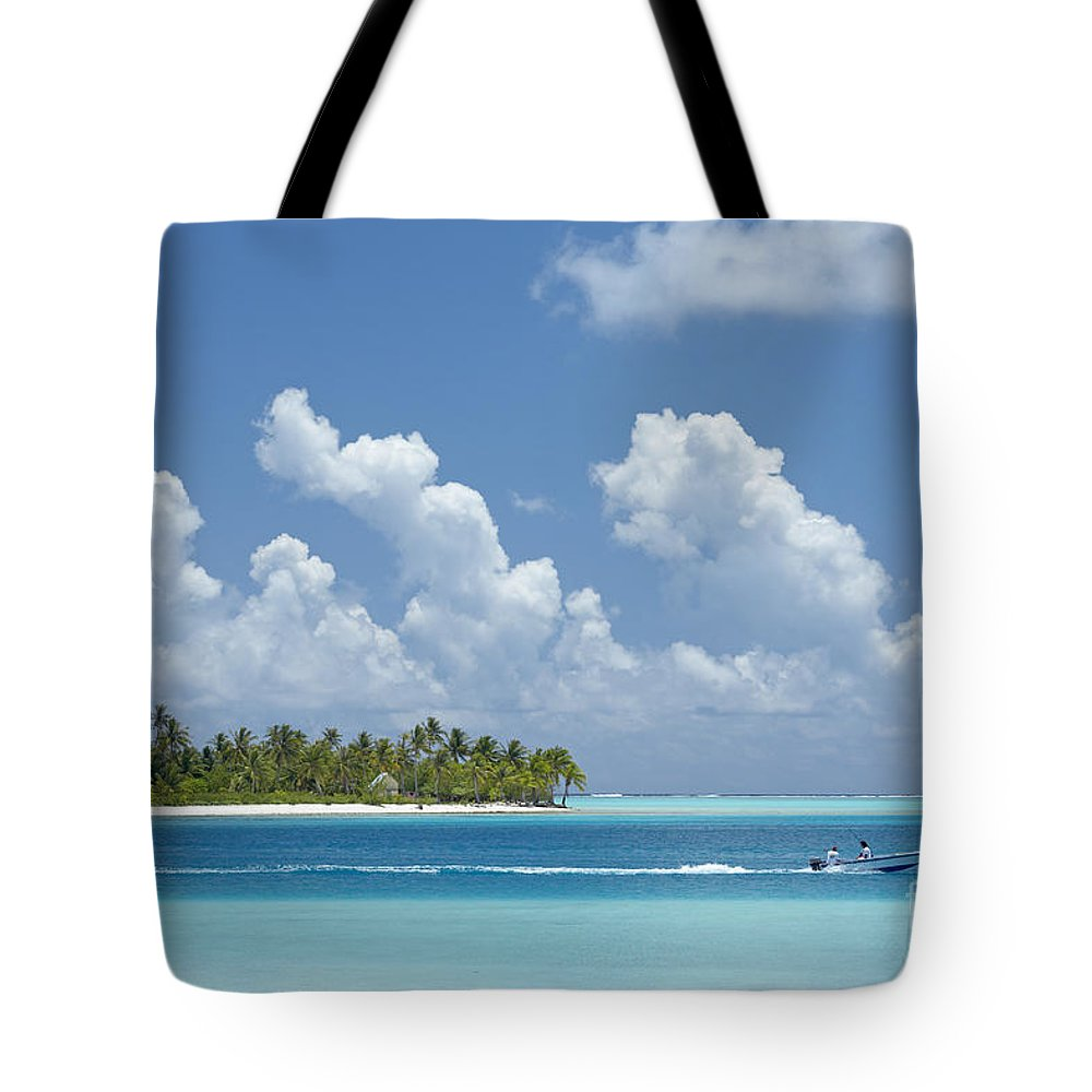 Alongside Tote Bag featuring the photograph Boating In A Tahitian Lagoon by Kyle Rothenborg - Printscapes