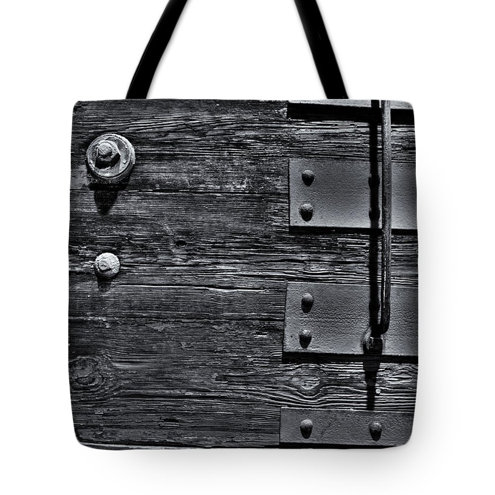 Wood Tote Bag featuring the photograph Bolted Wood by Scott Wyatt