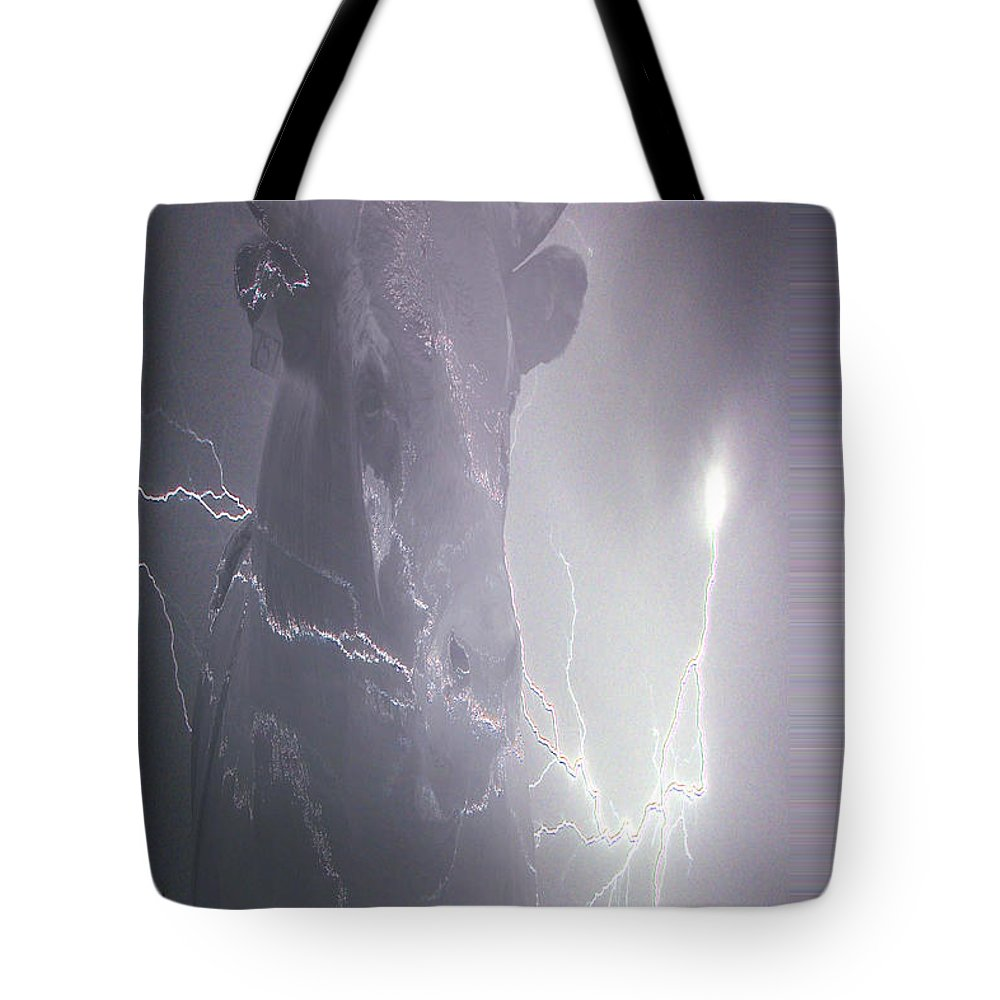 Lightening Lightning Cattle Bull Horns Cow Animal Rodeo Bullfighter Saskatchewan Artist Tote Bag featuring the photograph Bolting Bull by Andrea Lawrence