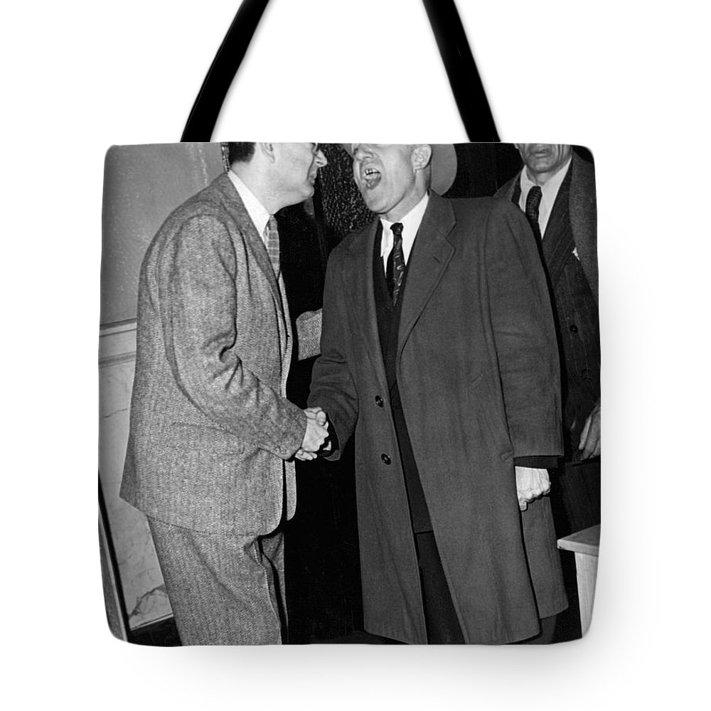 1940s Tote Bag featuring the photograph Breath Smelling Doorman by Underwood Archives