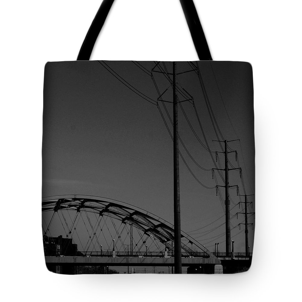 Metal Structures Tote Bag featuring the photograph Bridge And Power Poles At Dusk by Angus Hooper Iii