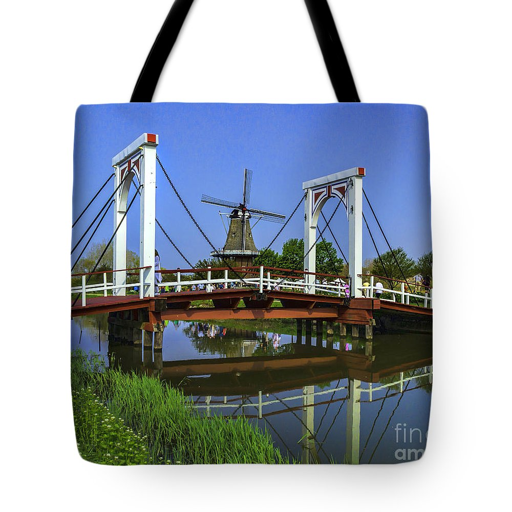 Holland Tote Bag featuring the photograph Bridge And Windmill by Nick Zelinsky