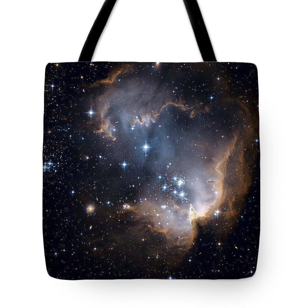 Galaxy Tote Bag featuring the photograph Bright Blue Newborn Stars Blast A Hole by ESA and nASA