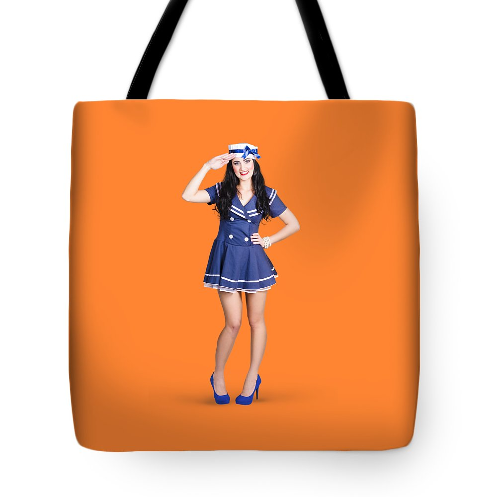 Sailor Tote Bag featuring the photograph British Navy Blue Pin Up Girl Saluting by Jorgo Photography - Wall Art Gallery