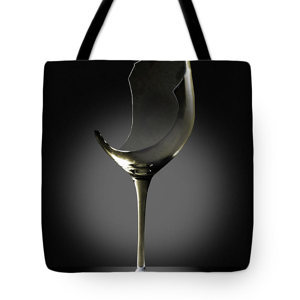 Glassware Tote Bag featuring the photograph Broken Wine Glass by Yuri Lev