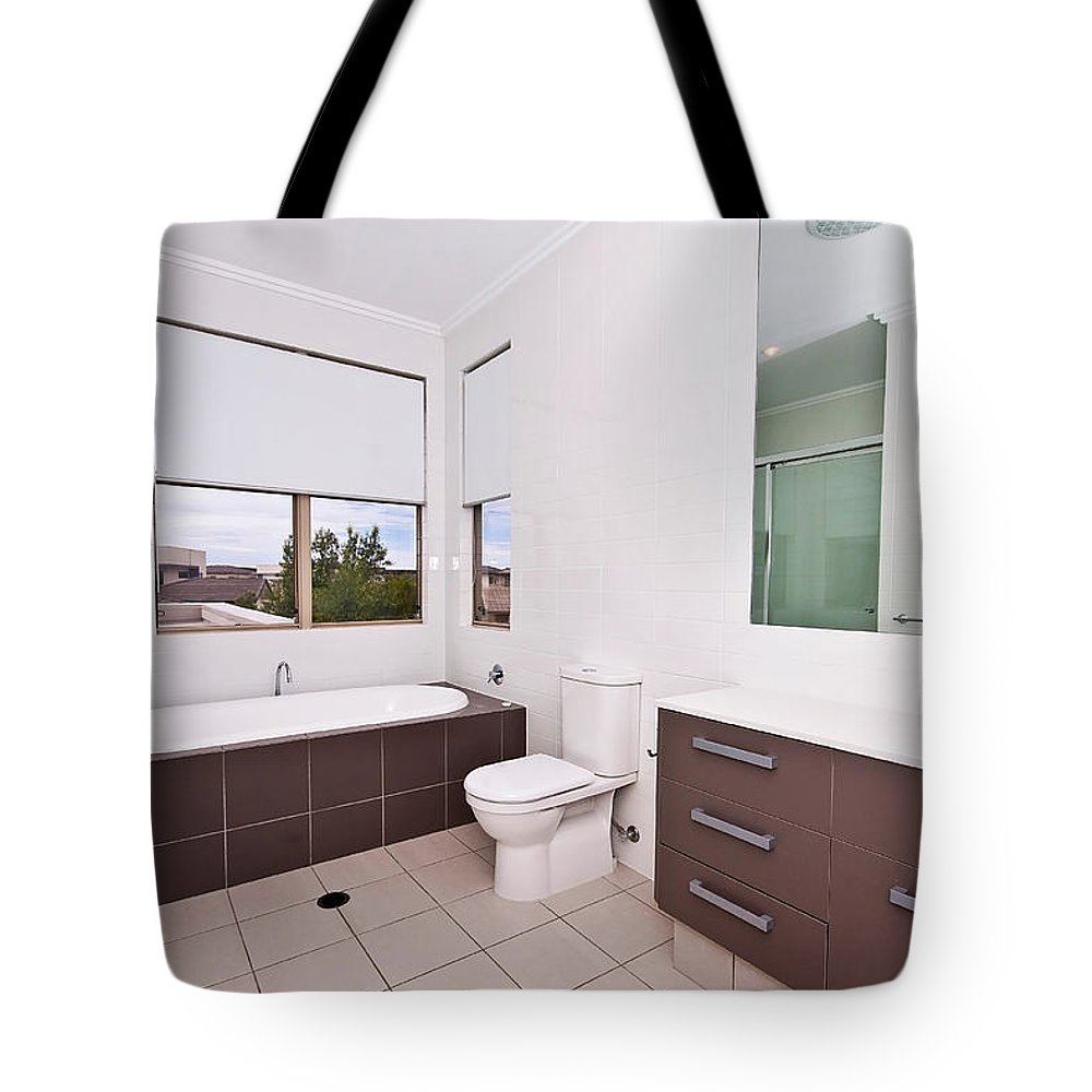 Brown Tote Bag featuring the photograph Brown And White Bathroom by Darren Burton