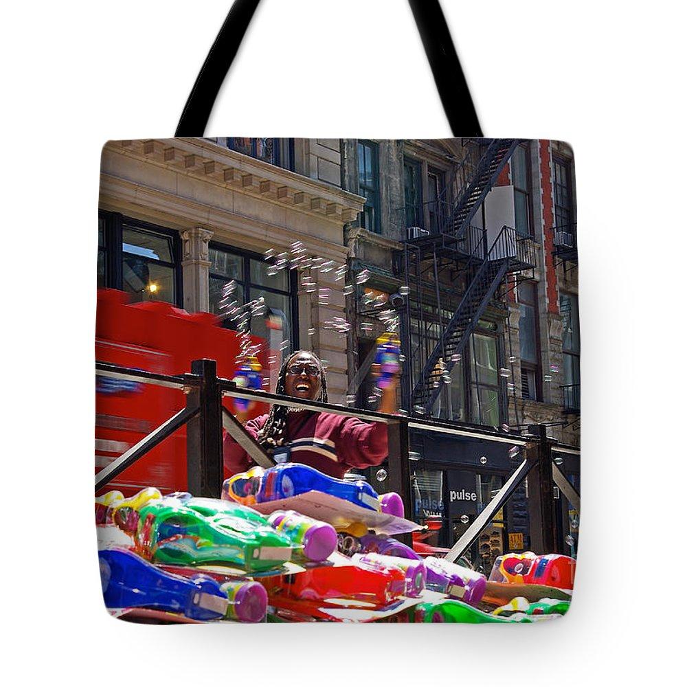 Bubbles Tote Bag featuring the photograph Bubble Gun Seller In New York by Zalman Latzkovich