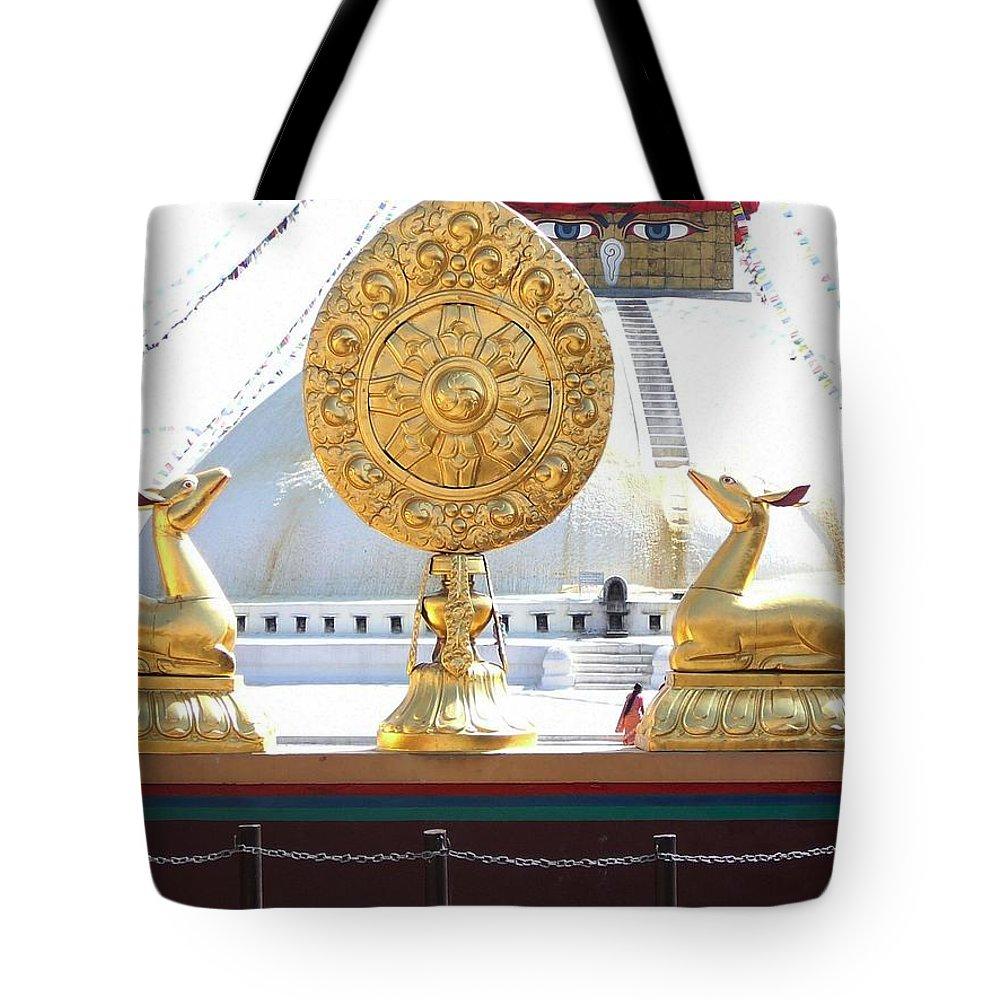 Dharma Tote Bag featuring the photograph Buddhist Dharma Wheel by Dagmar Batyahav