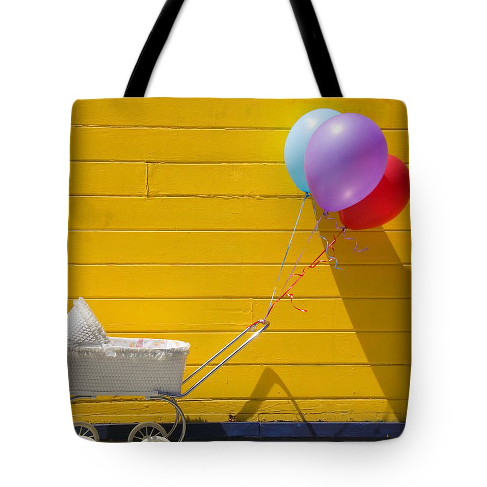 Wheel Tote Bag featuring the photograph Buggy And Yellow Wall by Garry Gay