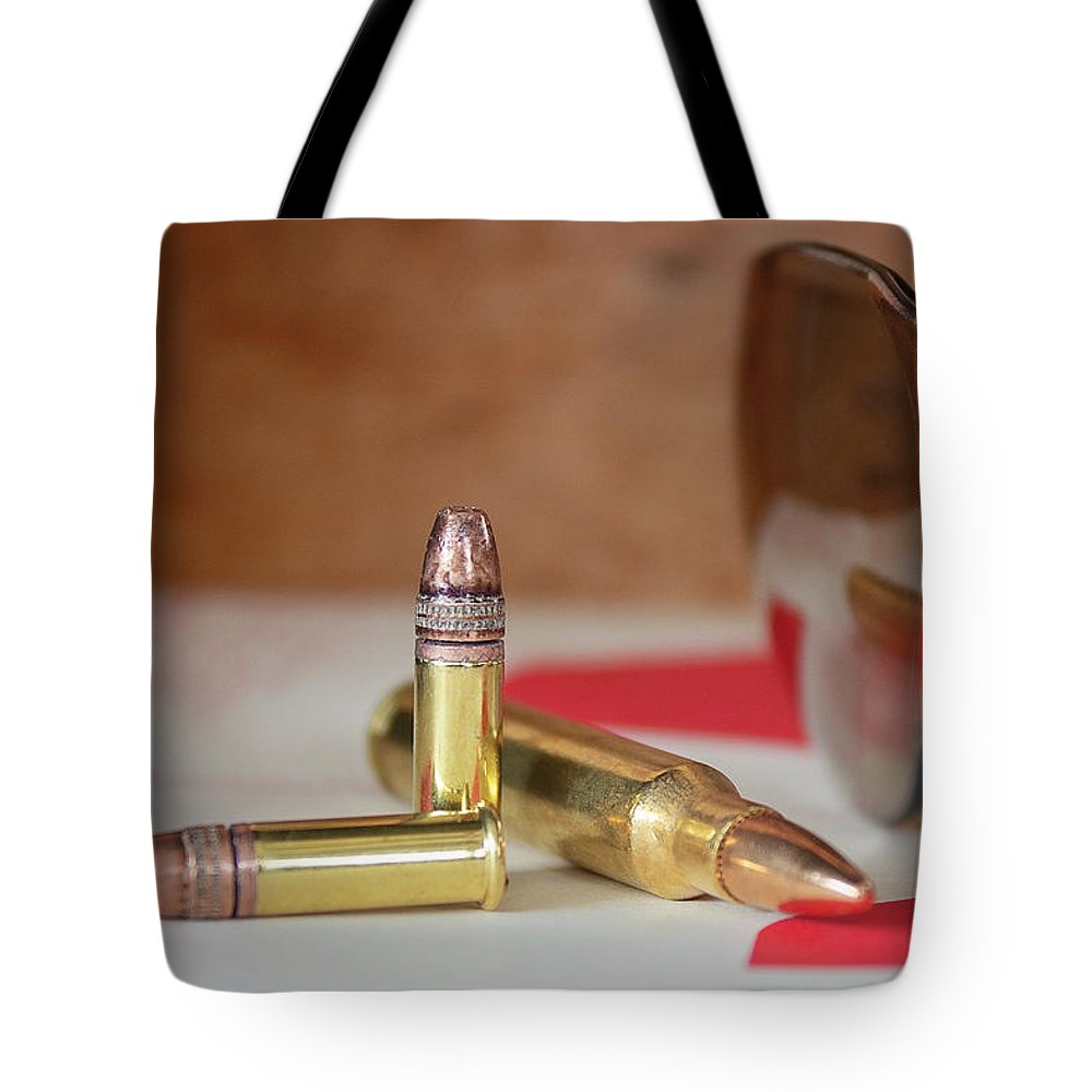Bullets Tote Bag featuring the photograph Bullets by Elizabeth Wilson