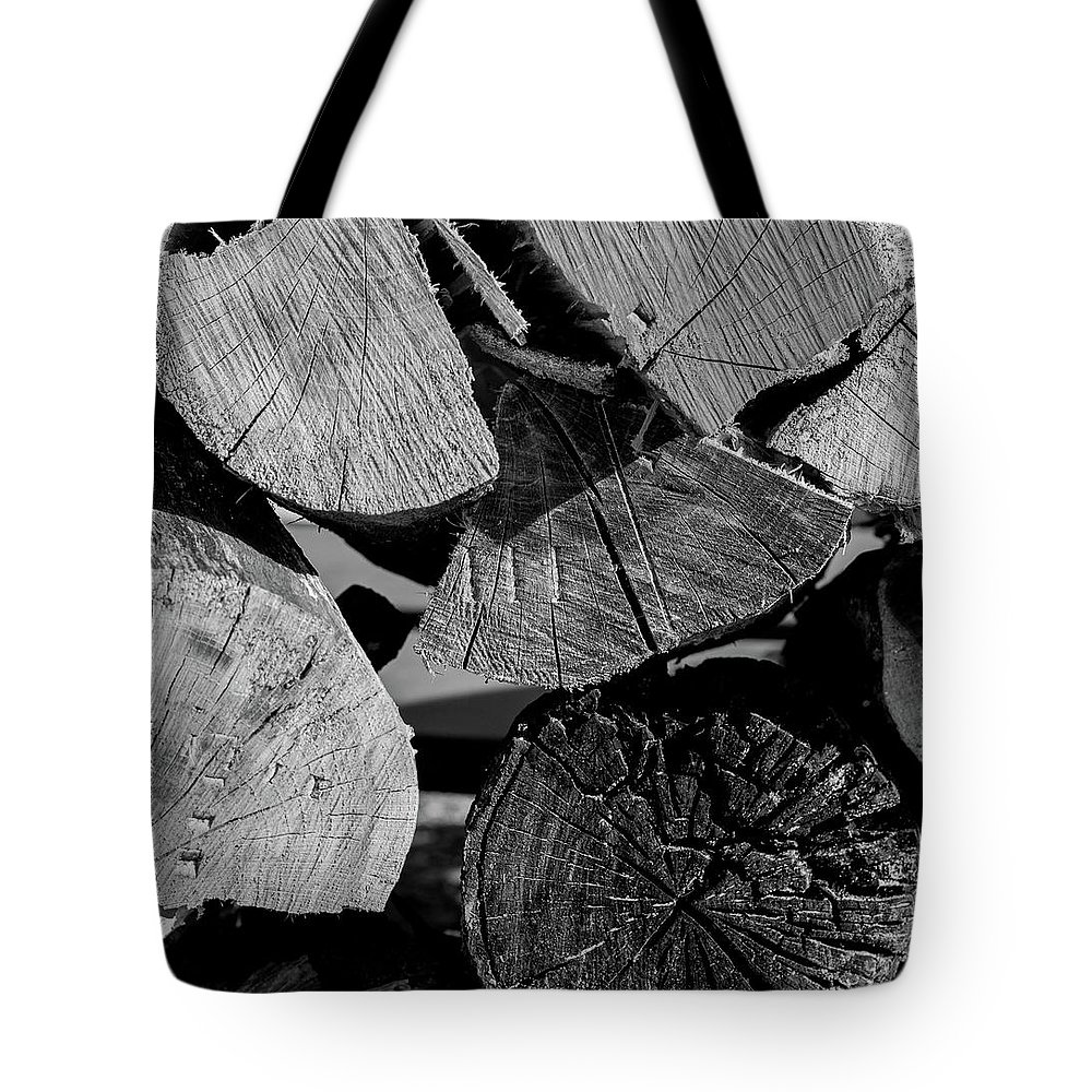Wood Tote Bag featuring the photograph Burned Wood In The Pile by By Way of Karma