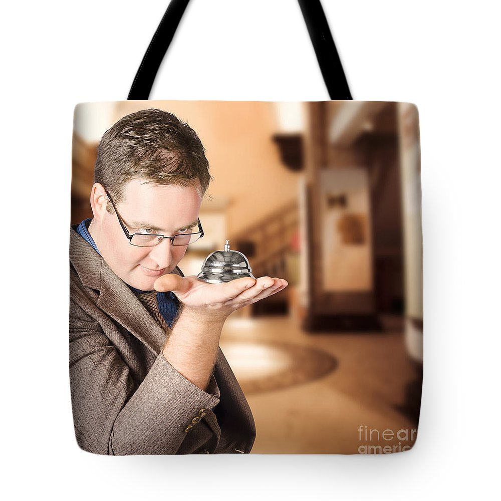 Service Tote Bag featuring the photograph Business Man With Service Bell. Consumer Advice by Jorgo Photography - Wall Art Gallery