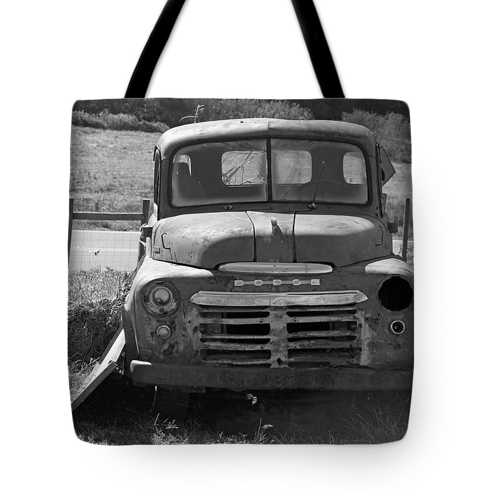 Truck Tote Bag featuring the photograph Bygone Dodge In Black And White by Suzanne Gaff