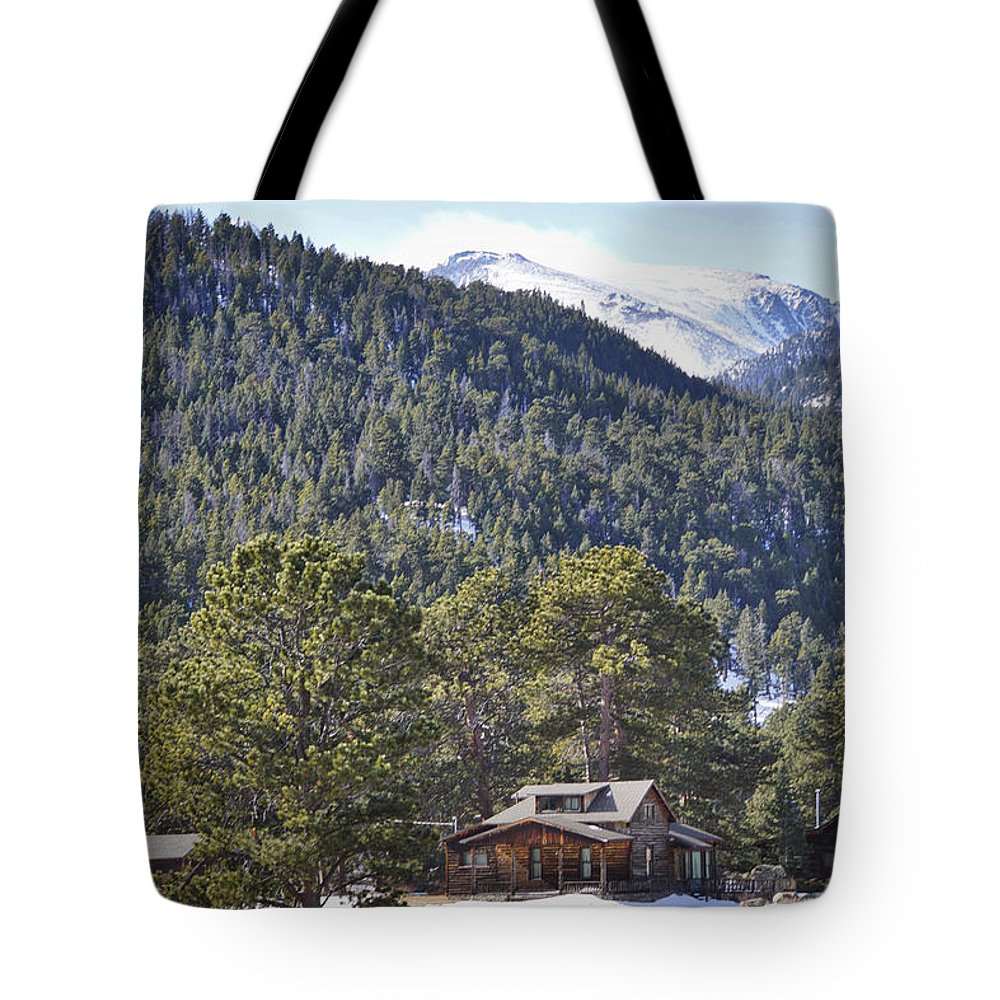 Rocky Mountains Tote Bag featuring the photograph Cabin Light by Paki O'Meara
