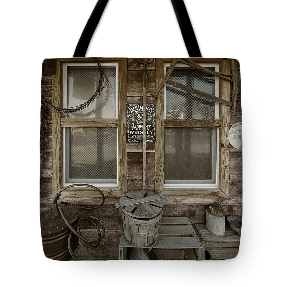 Calvins Garage Tote Bag featuring the photograph Calvins Garage In Deshler Nebraska by Art Whitton