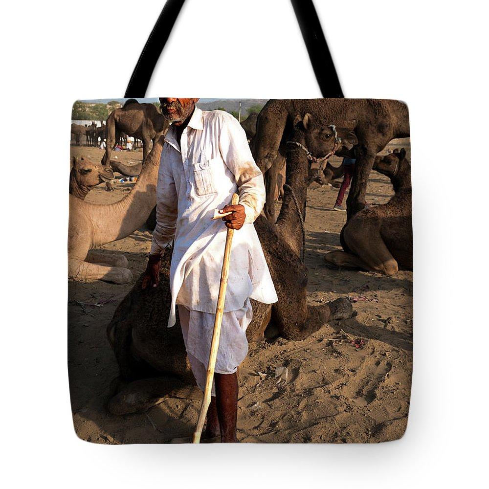 Camel Trader Tote Bag featuring the photograph Camel Trader Pushkar by Doug Matthews