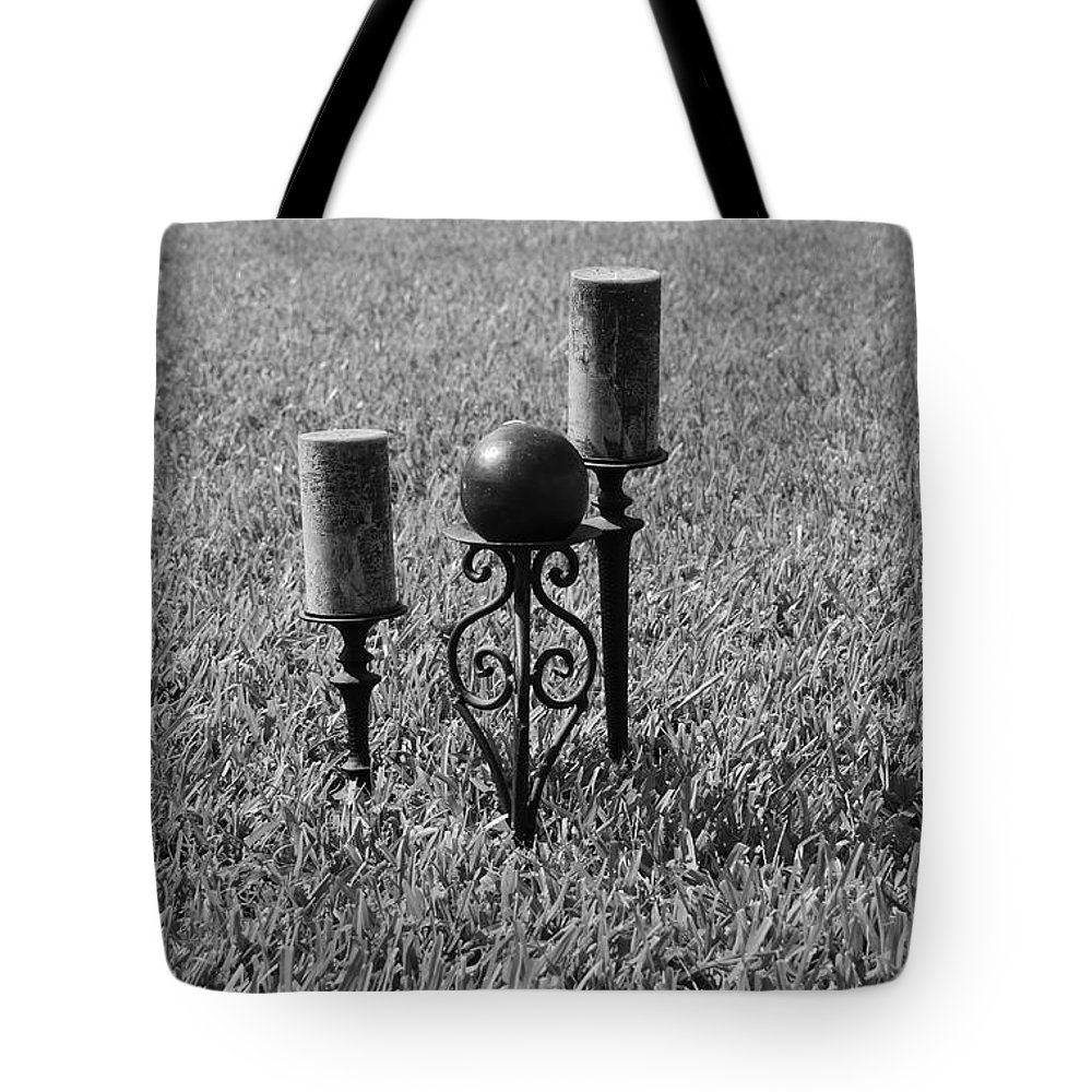 Black And White Tote Bag featuring the photograph Candles In Grass by Rob Hans