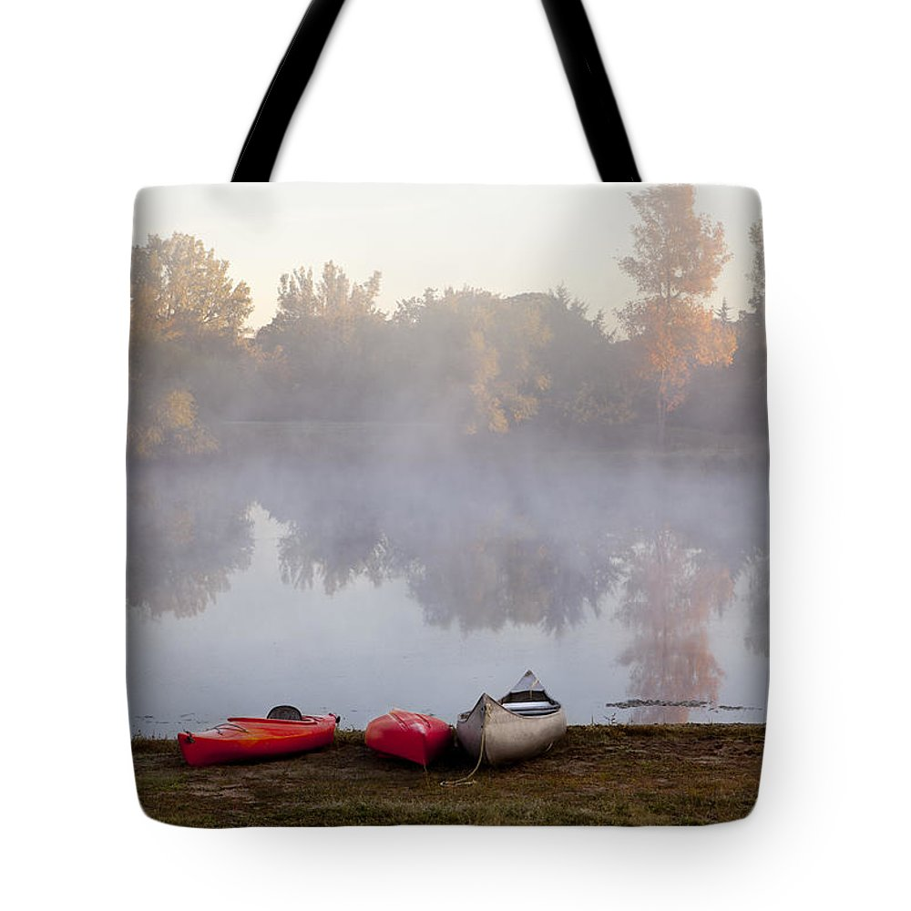 Three Tote Bag featuring the photograph Canoes By A Foggy Lake In Autumn by Sharon Foelz