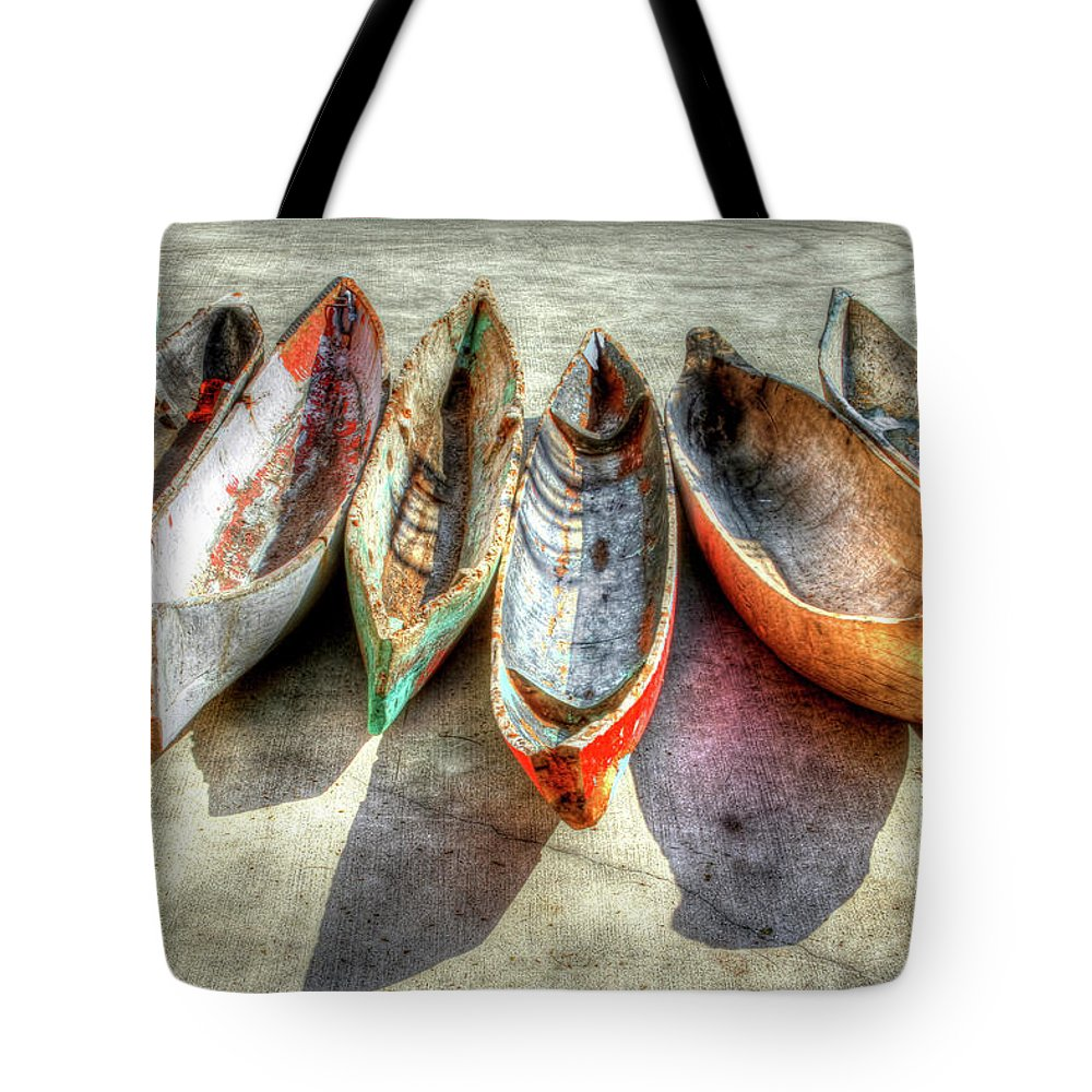 The Tote Bag featuring the photograph Canoes by Debra and Dave Vanderlaan