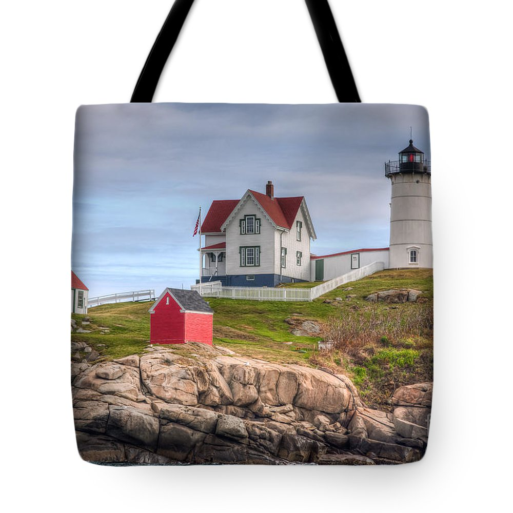 America Tote Bag featuring the photograph Cape Neddick Nubble Lighthouse I by Clarence Holmes