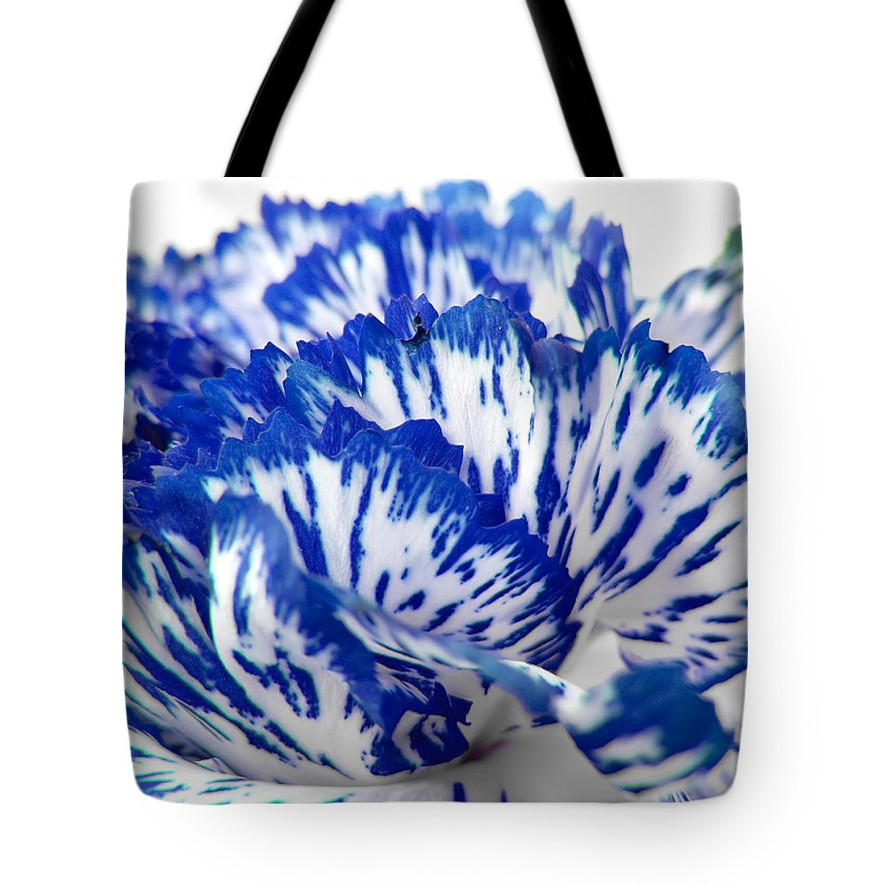 Carnation Tote Bag featuring the photograph Carnation by Daniel Csoka