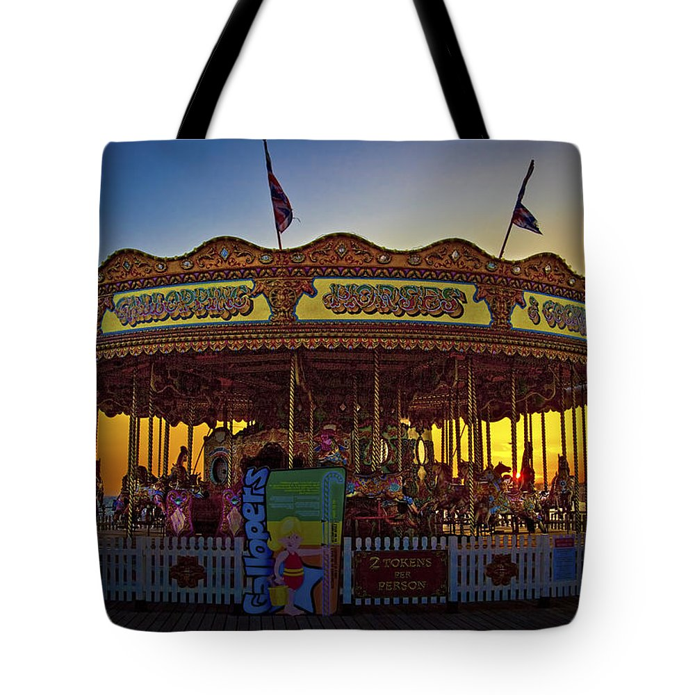 Carousel Tote Bag featuring the photograph Carousel Sunset by Chris Lord