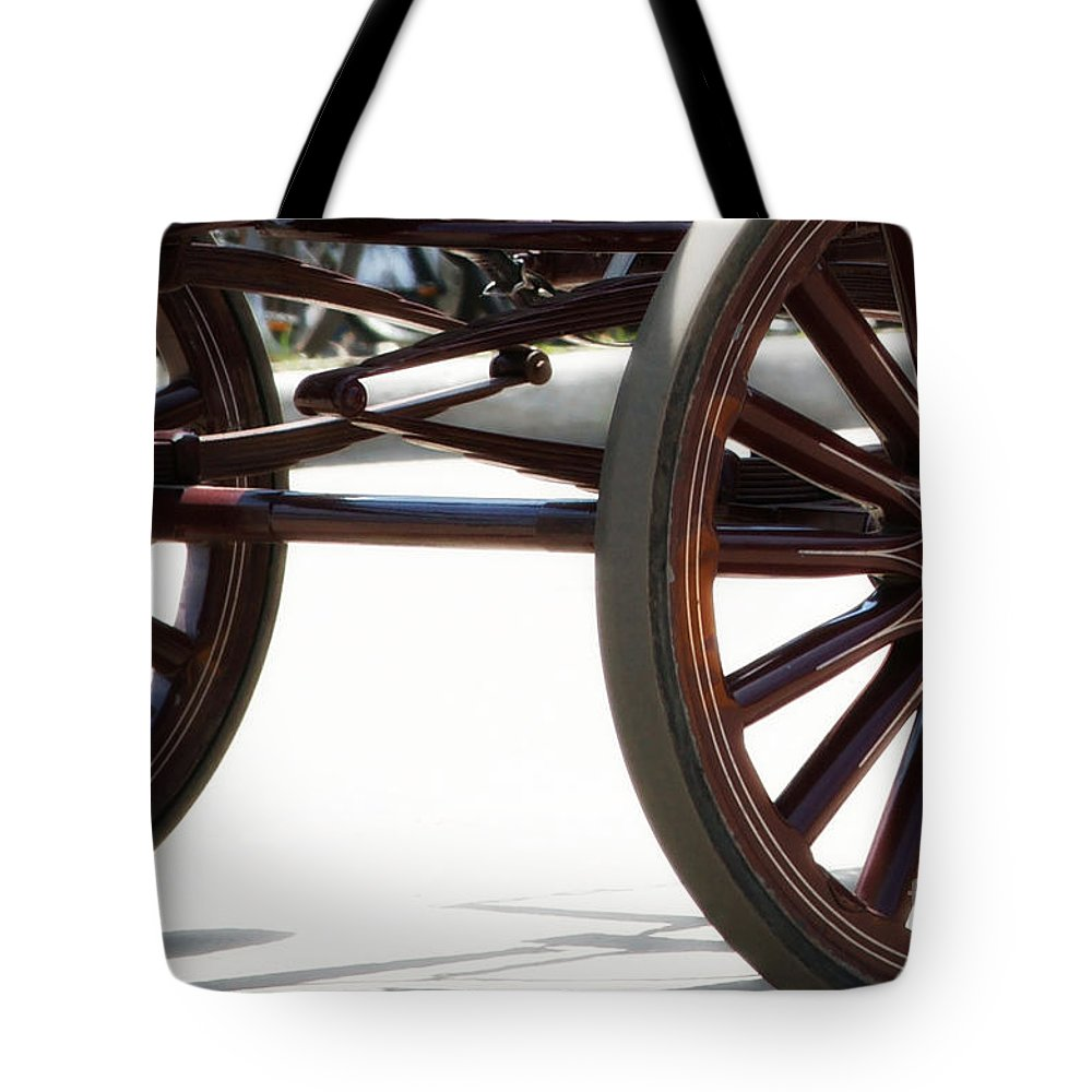 Carriage Tote Bag featuring the photograph Carriage Wheels by Linda Shafer