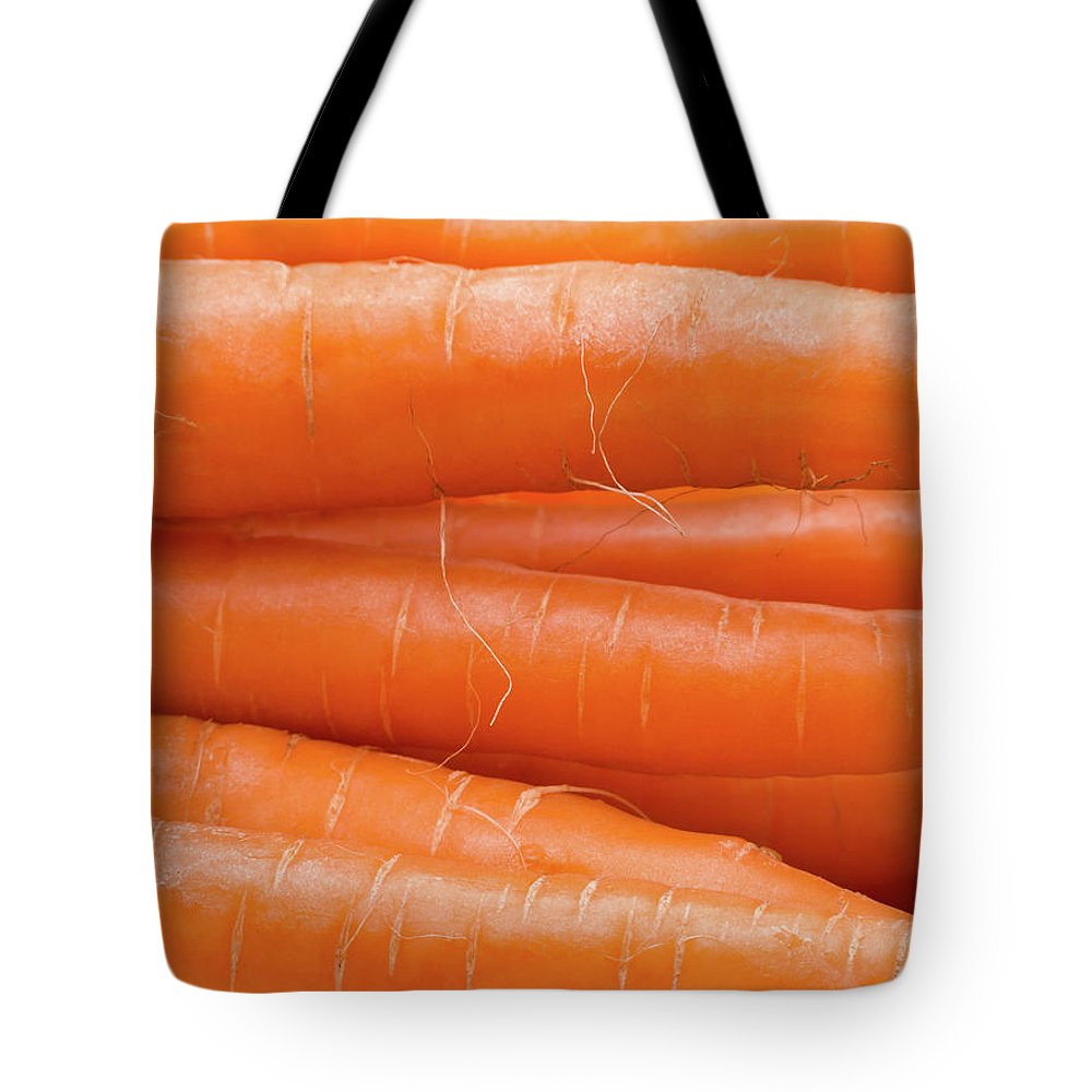 Carrots Tote Bag featuring the photograph Carrots by Wim Lanclus