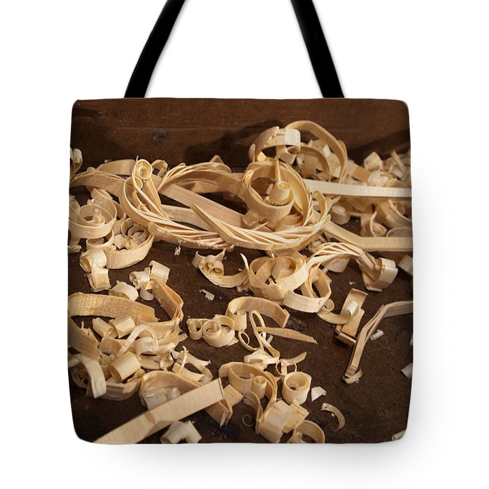 Wood Carving Tote Bag featuring the photograph Carving Curls by Grant Groberg