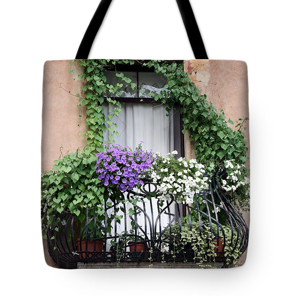 Windows And Doors Tote Bag featuring the photograph Cascading Floral Balcony by Donna Corless