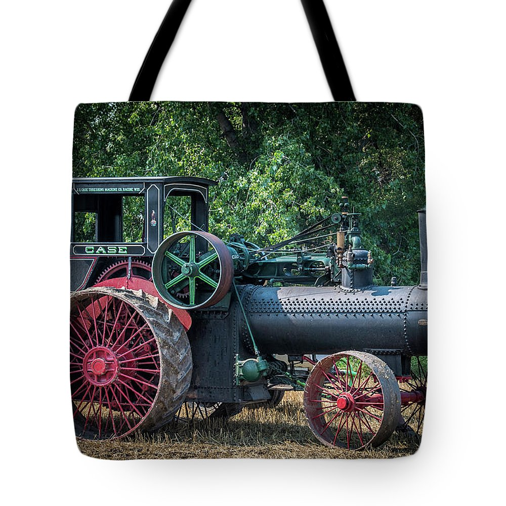 Case Tote Bag featuring the photograph Case Waiting To Work by Paul Freidlund