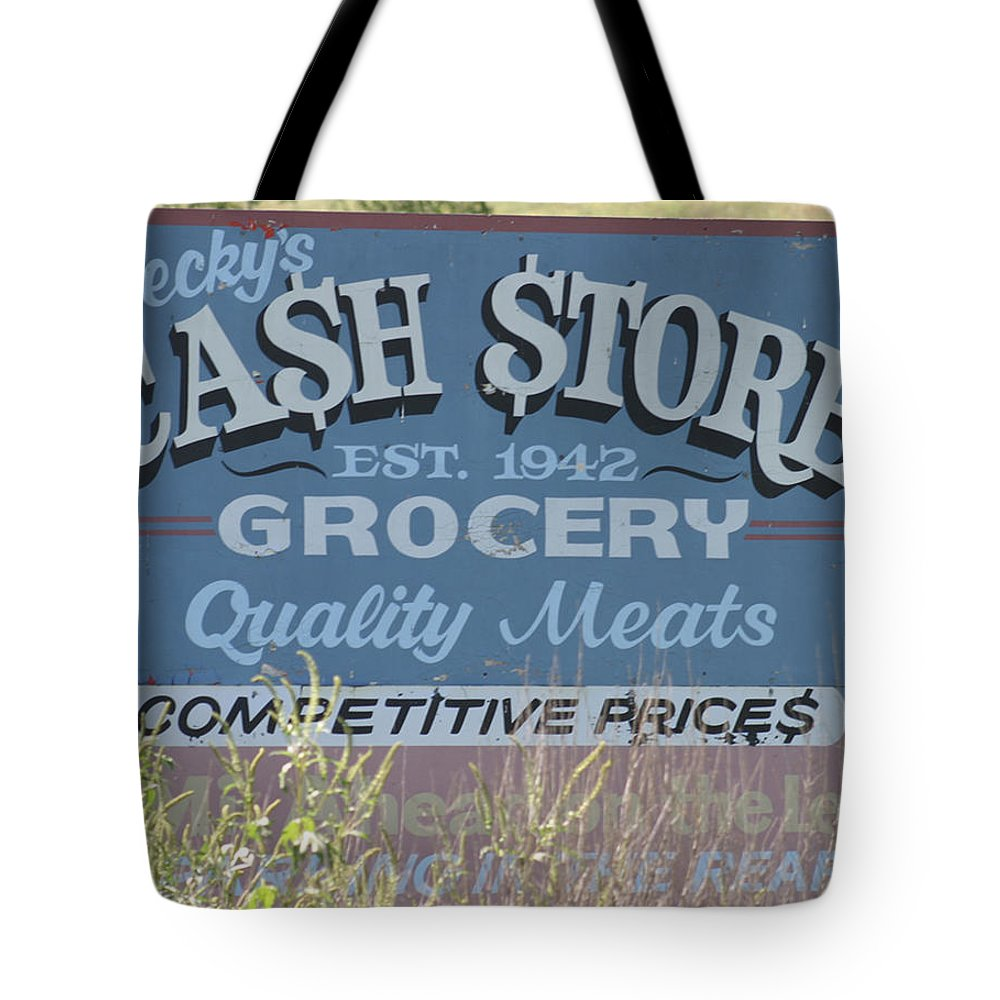 Signs Tote Bag featuring the photograph Cash Is King by Bjorn Sjogren