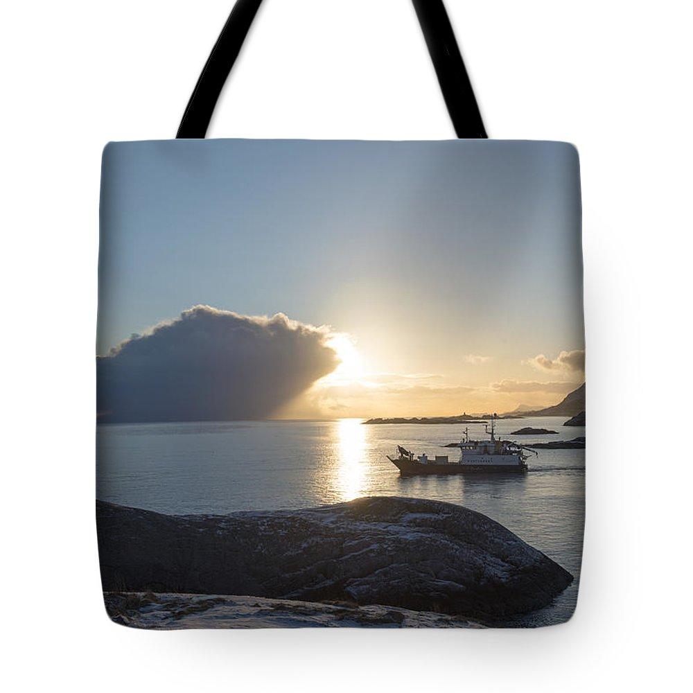 Light Tote Bag featuring the photograph Cast A Giant Shadow... Reine Lofoten by Dubi Roman