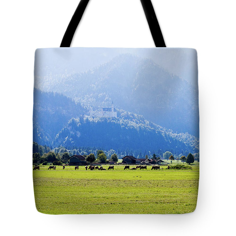 Neuschwanstein Tote Bag featuring the photograph Castle And Cattle by Bernard Barcos
